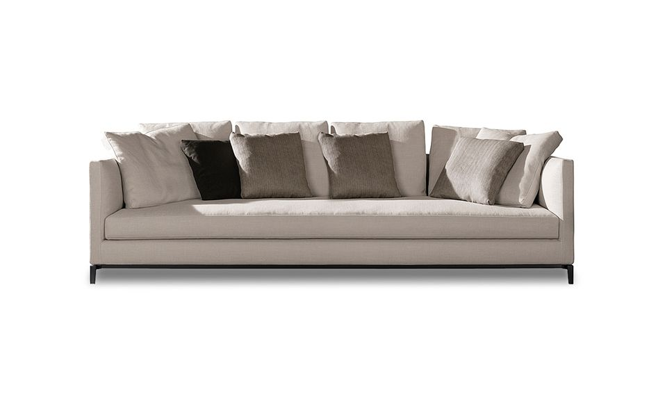A Sofa Whose Light Slender Structure Was Designed To Accommodate An Abundance Of Cushions For Comfortable Yet Decorative Effect
